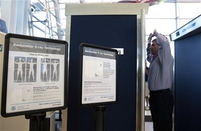 Transportation Security Administration manager Anthony Crimi demonstrates how a new full-body imaging machine will be used at one of the security checkpoints inside Lambert- St. Louis International Airport.  (AP)