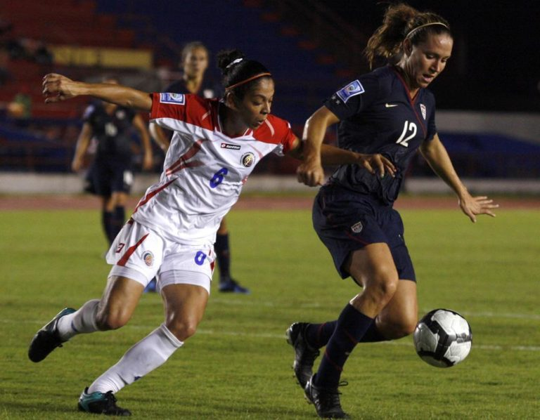 United States' Lauren Cheney, right, battles for the ball with Costa Rica's Daniela Cruz during a 2010 Women's World Cup qualifier soccer match in Cancun, Mexico, Monday Nov. 1, 2010. (AP)