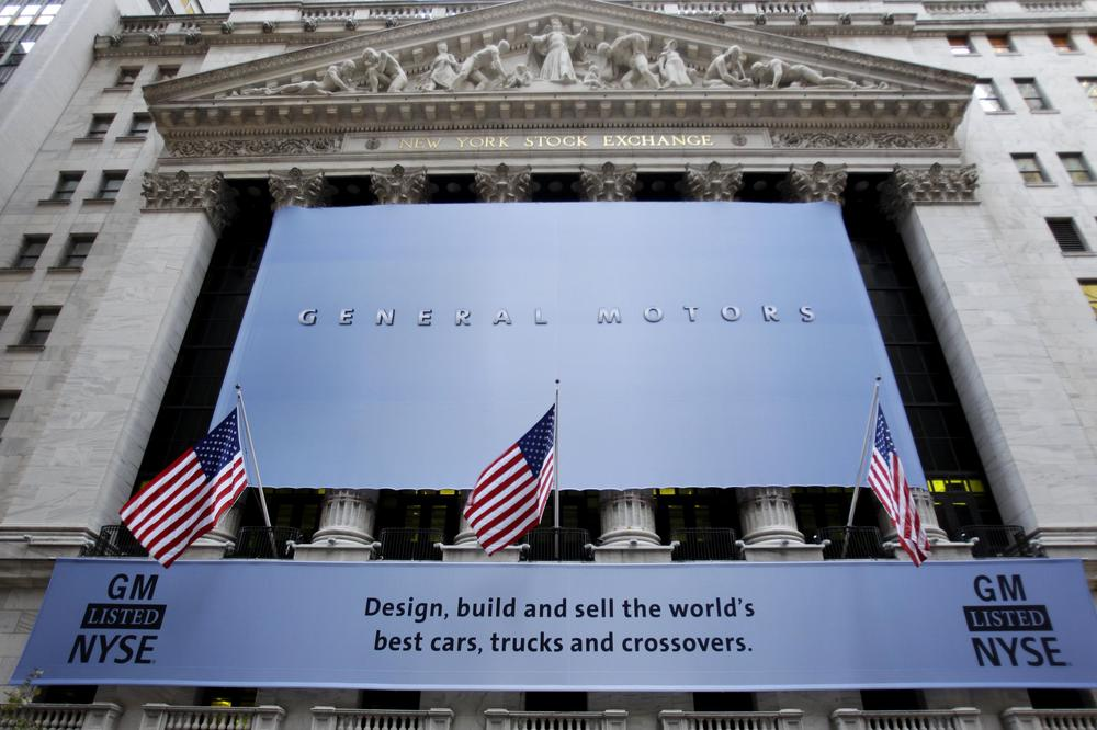 A banner displaying the name of General Motors covers the New York Stock Exchange in New York, Thursday. (AP)