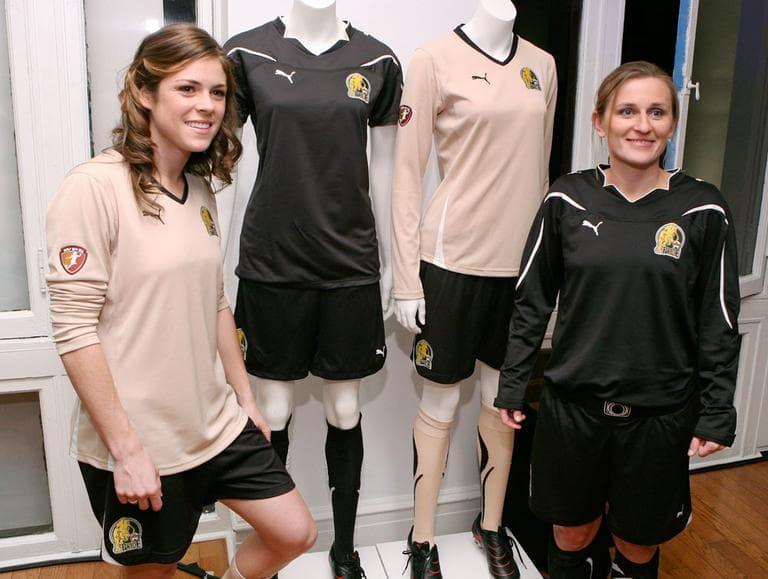 Then-draft pick Kelley O'Hara, left, and veteran player Tiffeny Milbrett model their new FC Gold Pride uniforms in Philadelphia on Jan. 15, 2010. (AP)