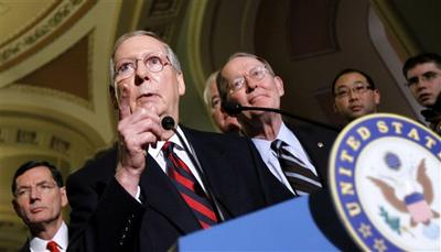 Senate Minority Leader Mitch McConnell of Ky., second from left, accompanied by Sen. John Barrasso, R-Wyo., left, and Sen. Lamar Alexander, R-Tenn., gestures during a news conference on Capitol Hill in Washington. (AP)