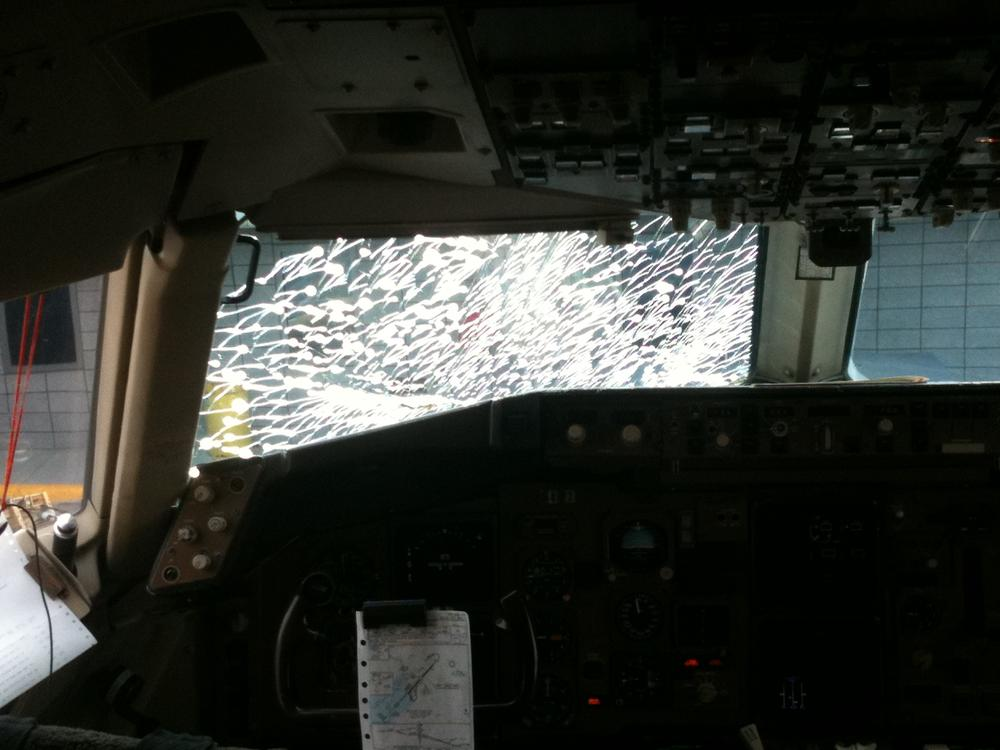 Cracked windshield in the cockpit of United Flight 881 (Andrew Phelps/WBUR)