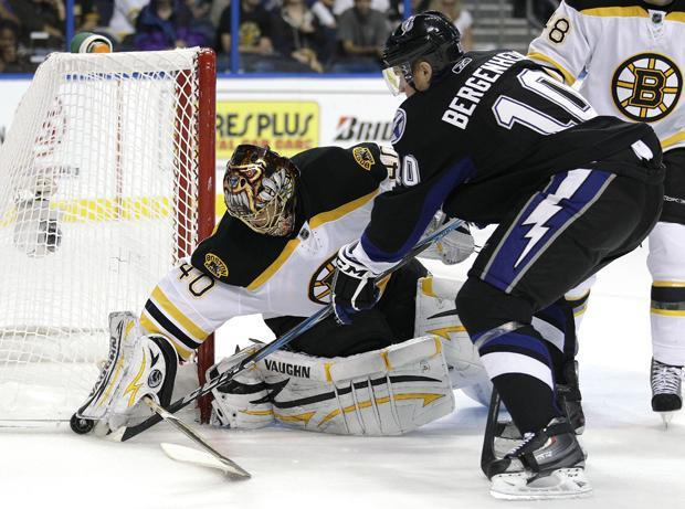 Tampa Bay left wing Sean Bergenheim (10) knocks the puck from Boston goalie Tuukka Rask, of Finland, (40) during the third period of the game on Monday in Tampa, Fla. (AP)