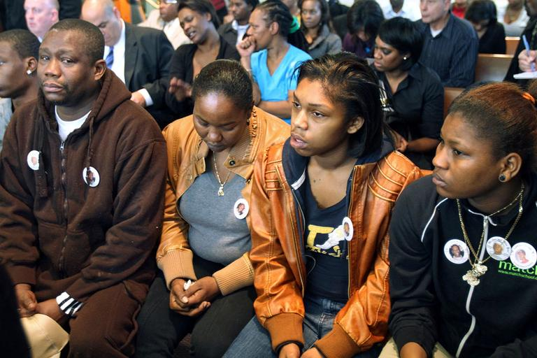 Friends and family of the victims attend the arraignment of Dwayne Moore Tuesday in Dorchester. Moore was not seen in court. (AP)