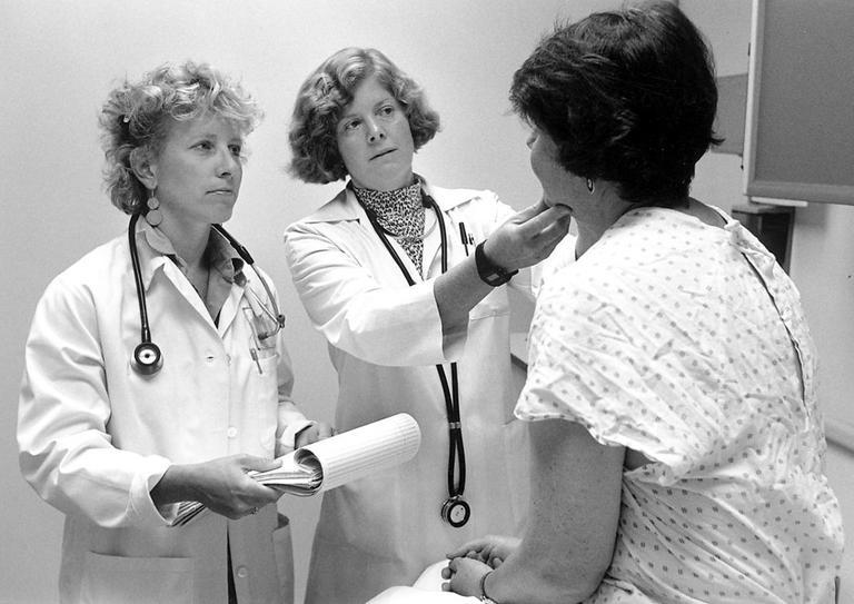 Doctors examine a patient. (Seattle Municipal Archives)