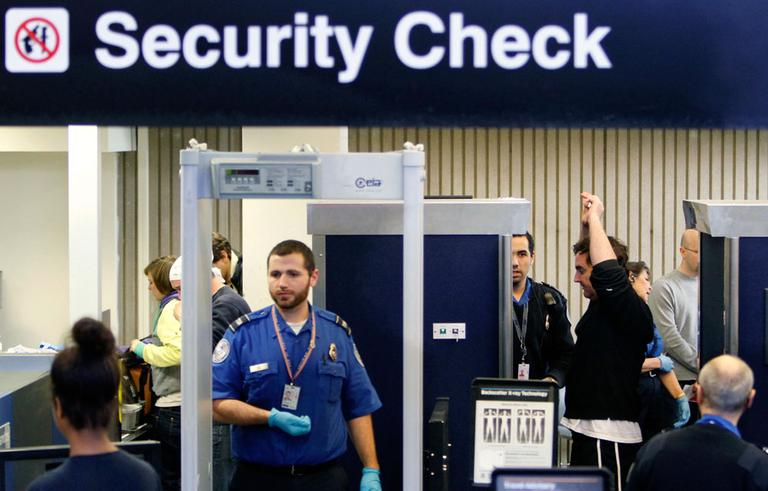 Passengers go through security, including a full-body scanner, at Logan International Airport in Boston on Wednesday. (AP)