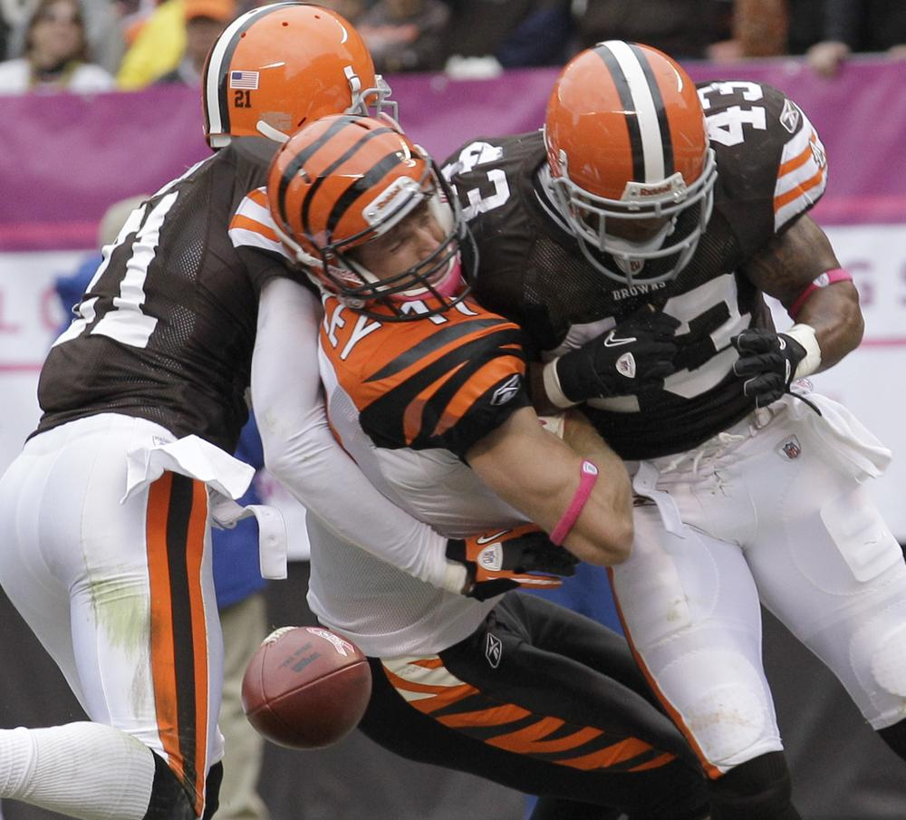 This hit left the Cincinnati Bengals' Jordan Shipley (center) with a concussion, and the Cleveland Browns' T.J. Ward (right) with a fine.  (AP)