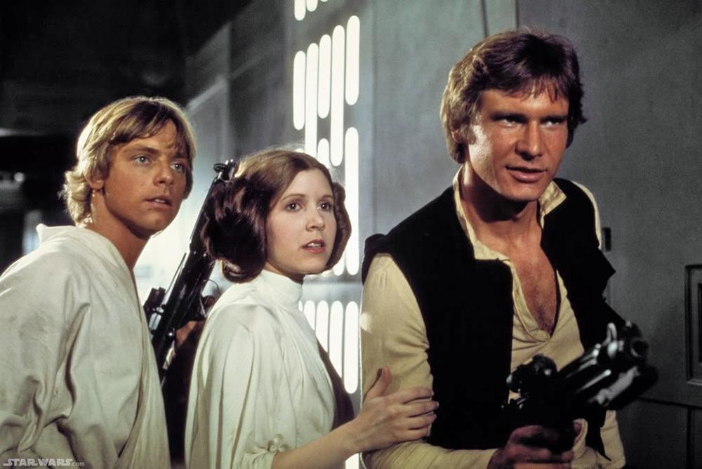 """Mark Hamill, Carrie Fisher and Harrison Ford as Luke Skywaker, Princess Leia and Han Solo appear in a scene from """"Star Wars.""""  (AP)"""