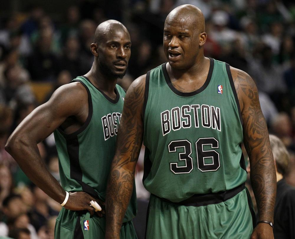 Shaquille O'Neal (36) talks with teammate Kevin Garnett during the second quarter of their win over the Toronto Raptors in Boston. (AP Photo/Winslow Townson)