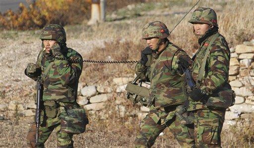 South Korean marines patrol on the South Korean island of Yeonpyeong on Friday, Nov. 26, 2010. (AP)