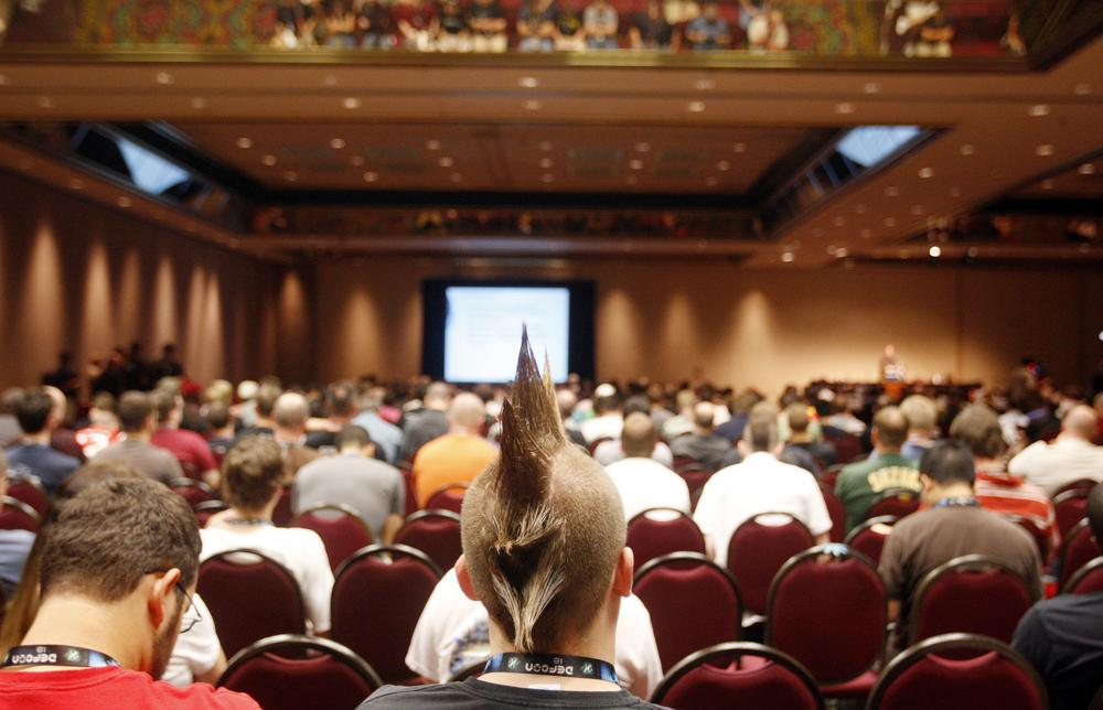 People listen to a presentation during the DefCon hacker conference in Las Vegas (AP)