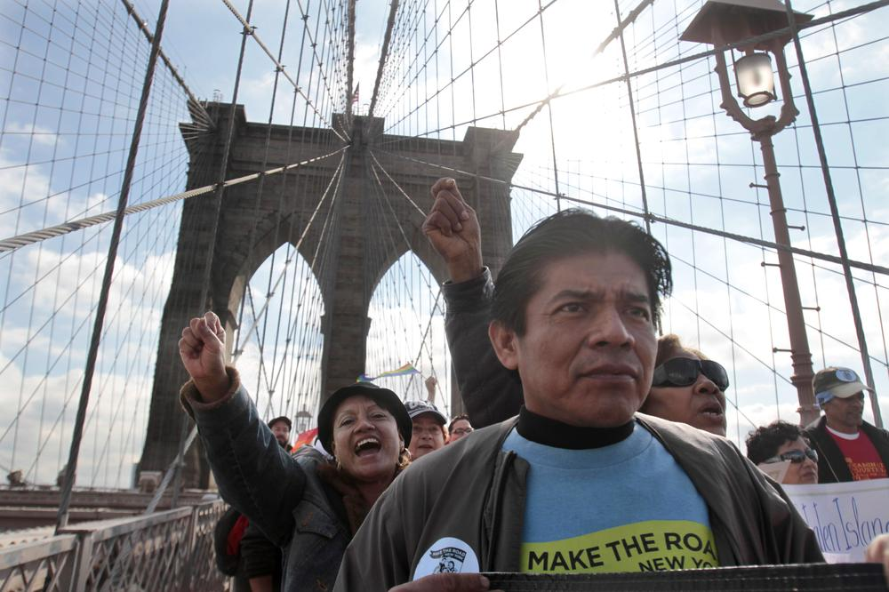 """A coalition of Latino workers and leaders march over New York's Brooklyn Bridge against a Department of Corrections policy to """"funnel"""" illegal immigrants into the Immigration and Customs Enforcement (ICE) detention and deportation program. (AP)"""