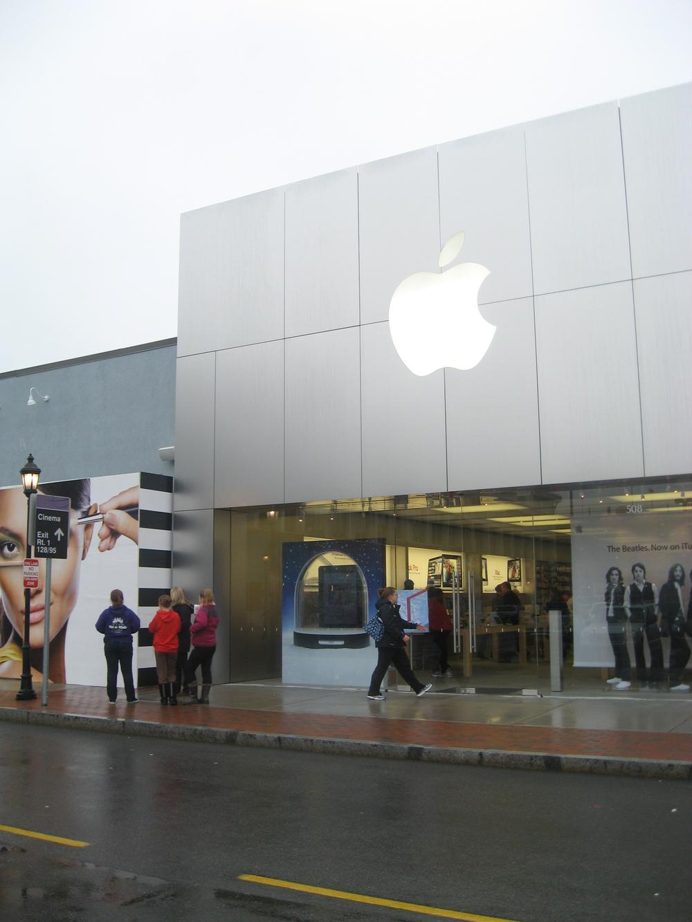The rain limited crowds somewhat at the Apple Store at the new Dedham Mall, Legacy Place. (Curt Nickisch/WBUR)