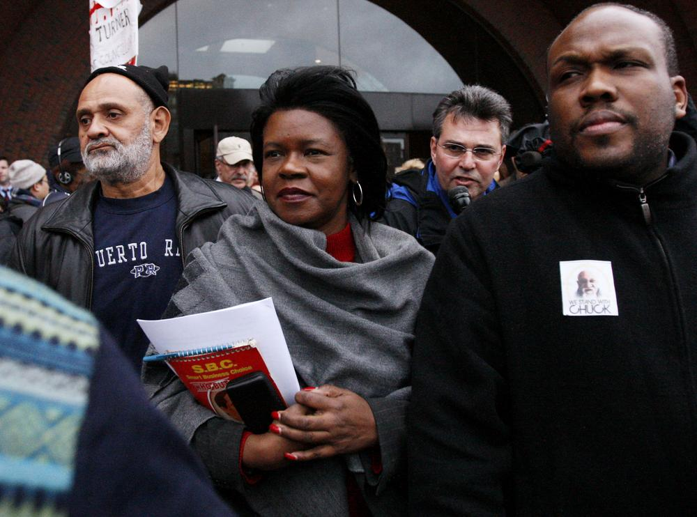 Former Massachusetts state Sen. Dianne Wilkerson, center, leaves federal court in Boston Dec. 10, 2008, where she pleaded not guilty to new charges in an ongoing corruption probe. She later pleaded guilty. (AP)