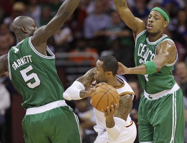 Boston forward Kevin Garnett and Boston forward Paul Pierce put pressure on Cleveland guard Ramon Sessions in the third quarter of the game on Tuesday in Cleveland. (AP)