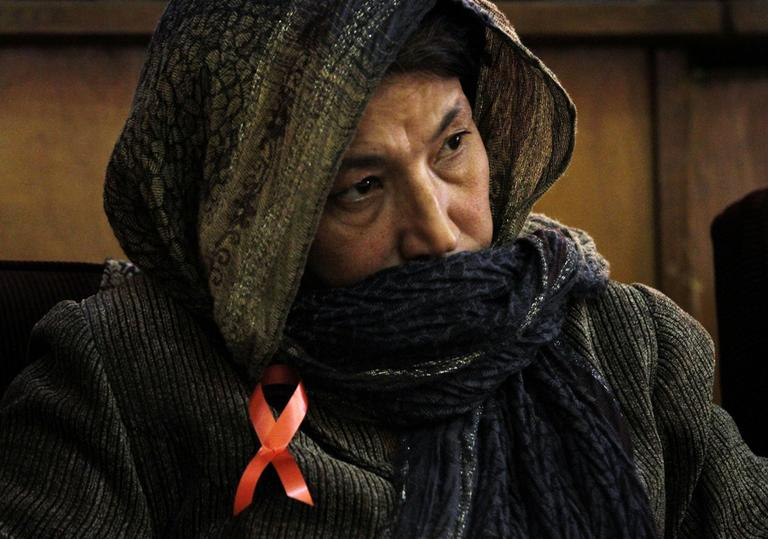 An attendee listens to speeches of the health minister,unseen, in Kabul, Afghanistan on Wednesday. The Afghan ministry of Health estimates there are around 2,000 - 3,000 HIV and AIDS cases all over the country.