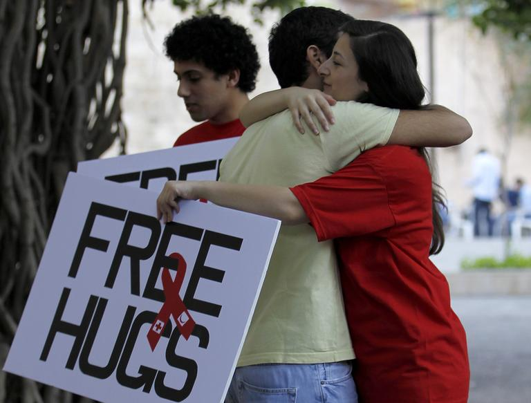 """Students of the American University of Beirut hug each other during the """"Free Hugs: Hugging is really not contagious"""" campaign  on campus in Beirut, Lebanon, Wednesday."""