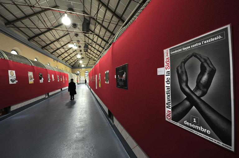A person walks past in a market announcing the fight against AIDS in Pamplona, northern Spain.