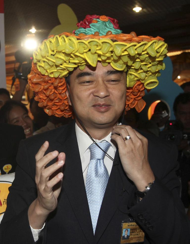 Thailand's Prime Miniter Abhisit Vejjajiva wears a hat made of condoms as he takes part in an anti-HIV/AIDS campaign ahead of World AIDS Day, in Bangkok, Thailand, Nov. 25.
