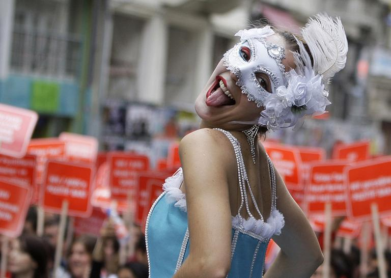 A woman in costume celebrate the World AIDS Day during a march in Istanbul, Turkey, Wednesday.