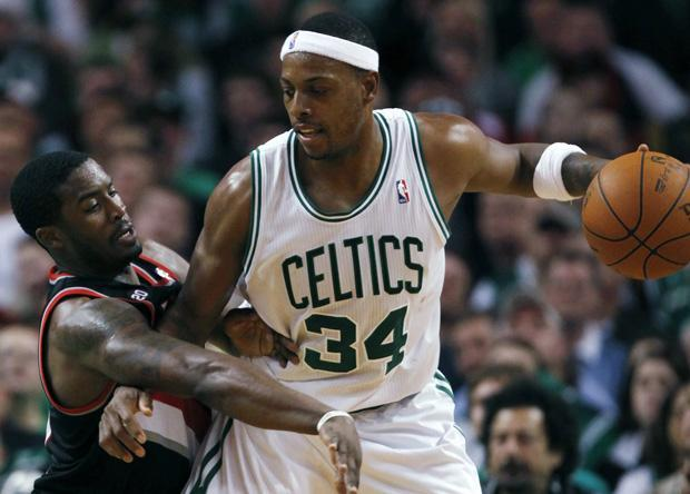 Boston's Paul Pierce (34) keeps the ball away from Portland's Wesley Matthews in the third quarter of an NBA basketball game in Boston on Wednesday. The Celtics won 99-95. (AP)