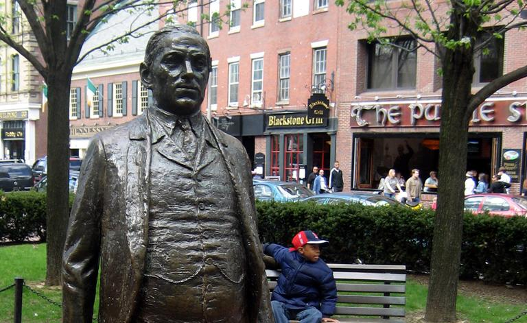 James M. Curley is honored with two statues near Faneuil Hall. (wallyg/Flickr)