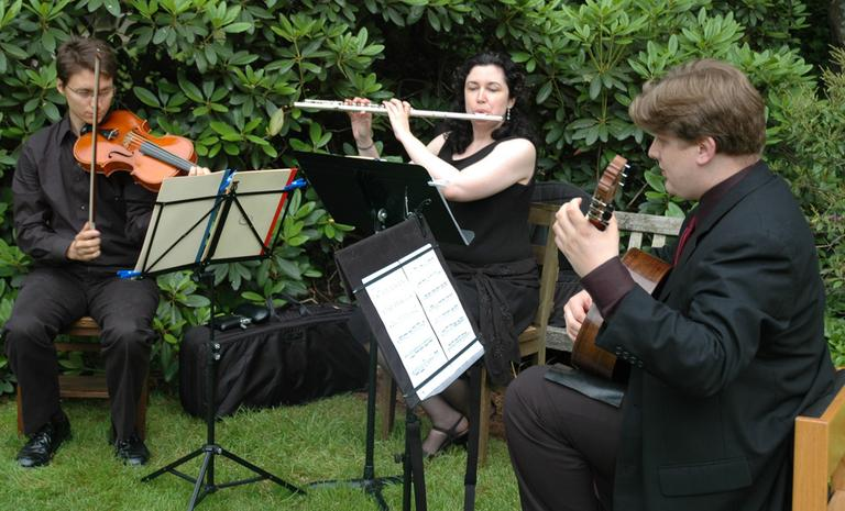 A trio from the Longy School of Music performs at a benefit for Mt. Auburn Cemetary. (friendsofmountauburn/Flickr)