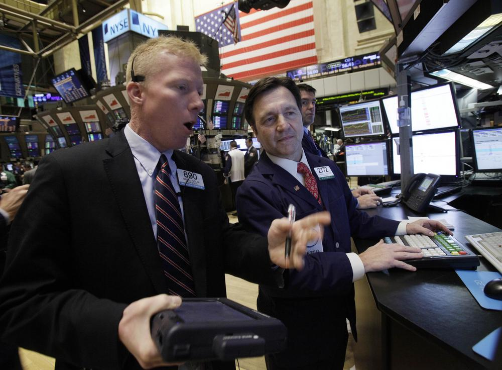 Trader Brian Dolan, left, works with specialist Thomas Facchine on the floor of the New York Stock Exchange. (AP)