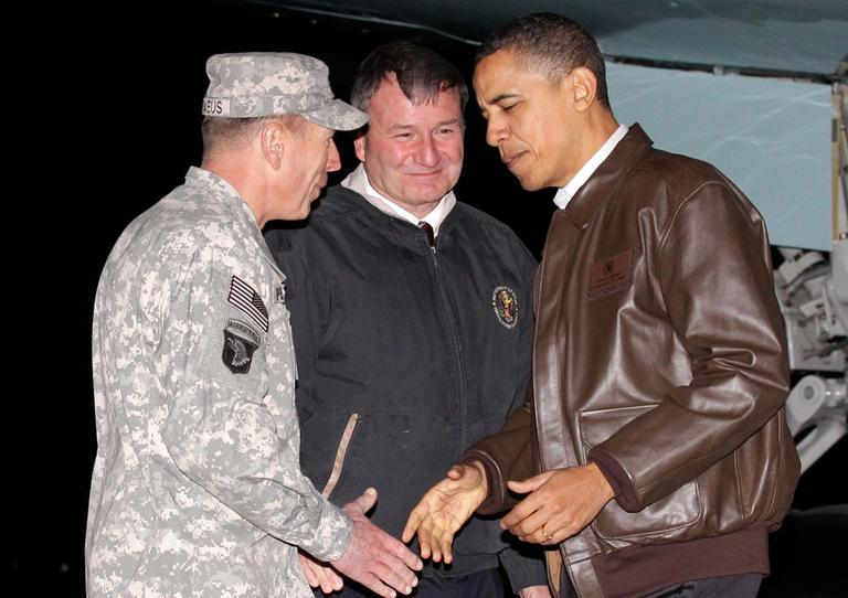 President Obama is greeted by Gen. David Petraeus, left, and U.S. Ambassador to Afghanistan Karl Elkenberry, center, at Bagram Air Base in Afghanistan on Friday. (AP)