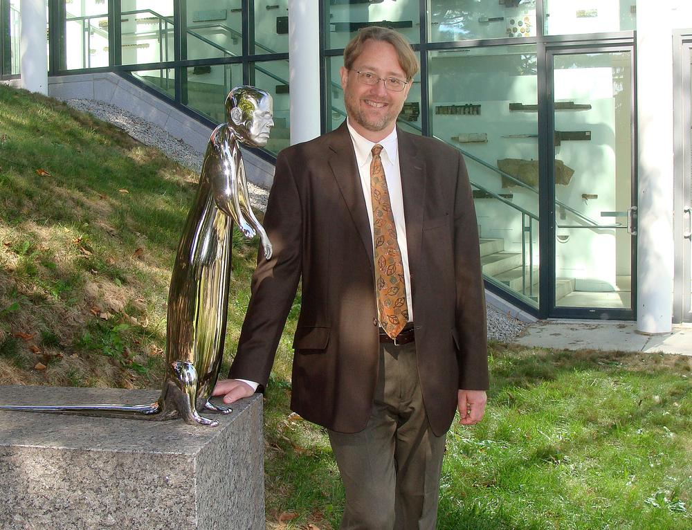Nick Capasso stands next to Otter, a sculpture by artist Rona Pondick, in the DeCordova Sculpture Park and Museum in Lincoln. (Courtesy of DeCordova Museum)
