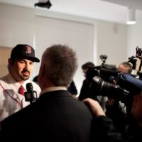 Adrian Gonzalez meets members of the Boston media. (Nicholas Dynan for WBUR)