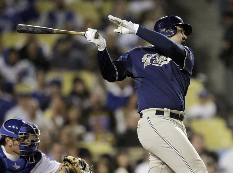 San Diego Padres' Adrian Gonzalez follows through on a double during a baseball game with the Los Angeles Dodgers in Los Angeles, Sept. 21. (AP)