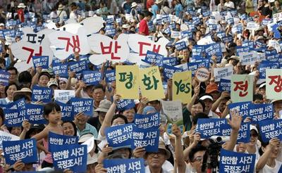 South Koreans hold pro-unification signs during a rally on Korea's Liberation Day in Seoul, South Korea. (AP)
