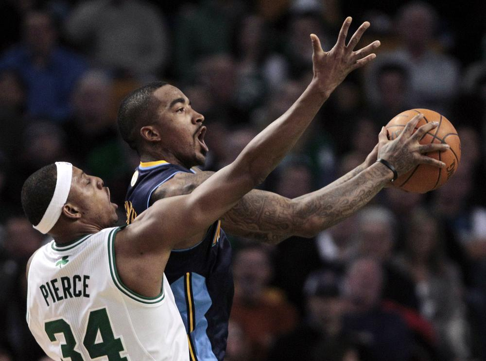 Denver Nuggets guard J.R. Smith, right, drives past Boston Celtics forward Paul Pierce during the second quarter of an NBA basketball game in Boston on Wednesday.(AP)