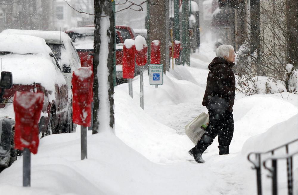 Snow storms are pounding Randolph, Ny., and other towns in the Great Lakes region.  In Meadville, Pa., a woman makes her across a snow covered sidewalk after storms dumped more than two feet of snow there. (AP)