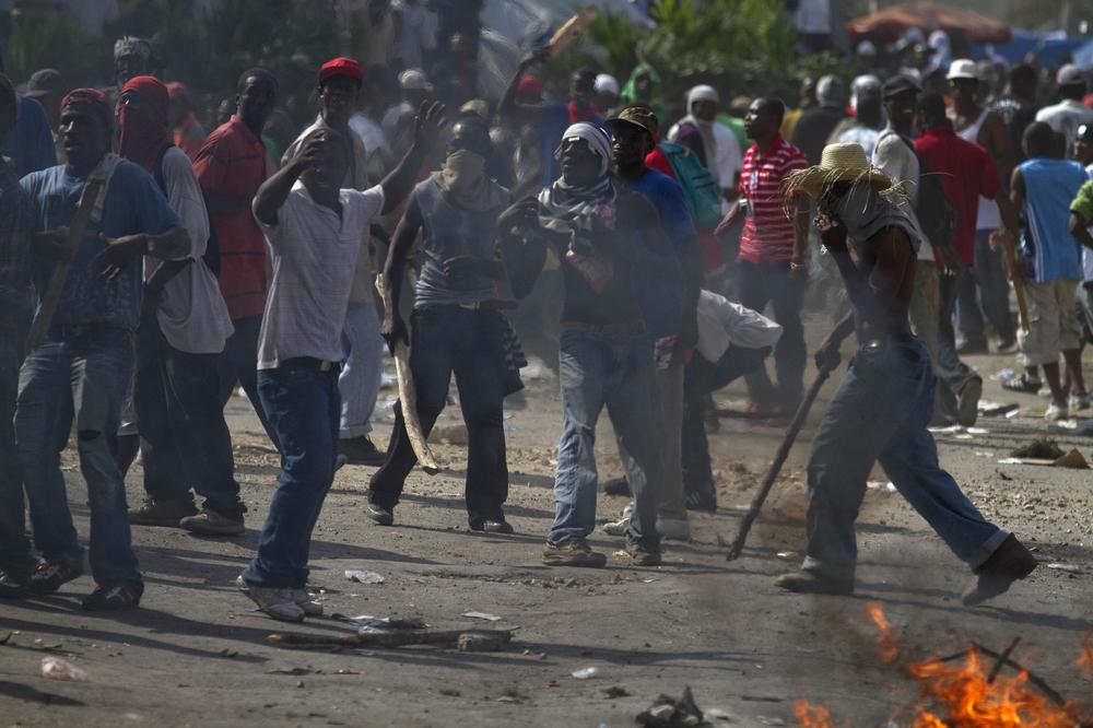 Supporters of presidential candidate Michel Martelly protest in Port-au-Prince, Haiti, after officials announced that Martelly would not advance to a presidential election runoff. (AP)
