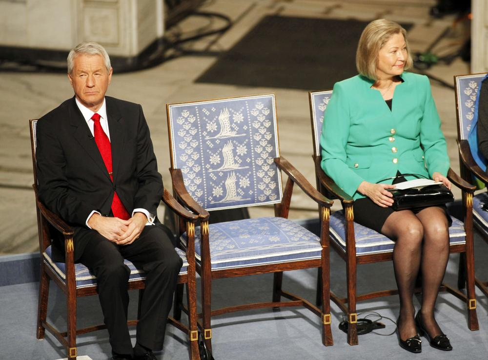 A chair representing Nobel Peace Prize laureate Liu Xiaobo sits empty during a ceremony honoring Liu at city hall in Oslo, Norway. At left is Nobel Commitee chairman Thorbjorn Jagland. At right is committee member Kaci Kullman Five. (AP)