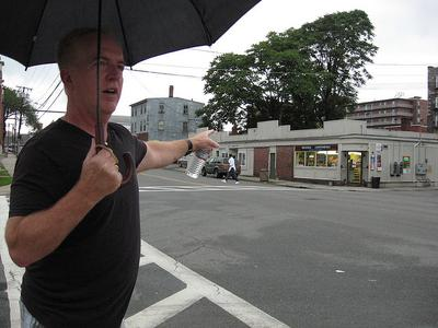 Richie Farrell points out landmarks from his past as a drug addict in Lowell, Massachusetts. (Huda Alhamda/Here & Now)
