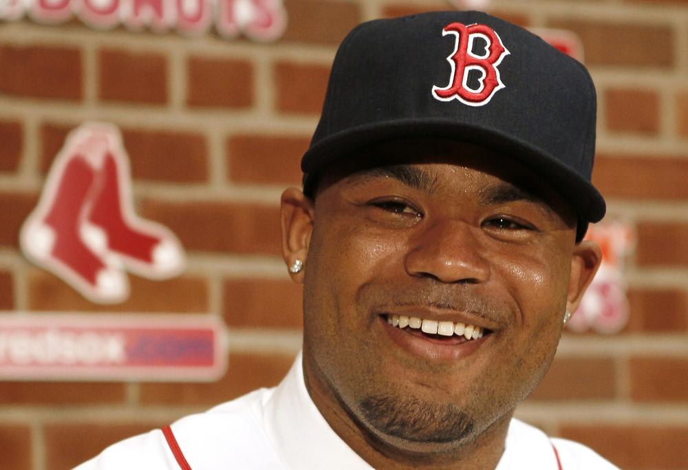 Carl Crawford smiles at a news conference announcing his signing by the Boston Red Sox at Fenway Park  Saturday. (AP Photo/Winslow Townson)
