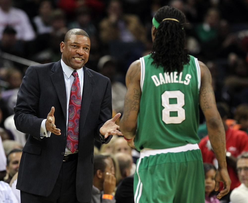 Celtics coach Doc Rivers, left, talks with Celtics guard Marquis Daniels in the second half against the Bobcats in Charlotte, N.C., Saturday. (AP)