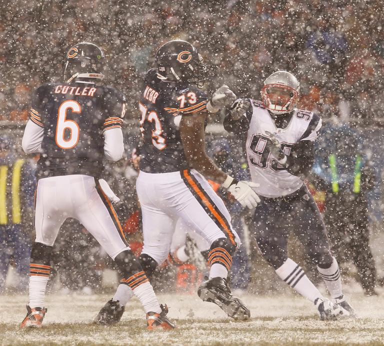 New England defensive end Eric Moore, right, rushes Chicago offensive tackle J'Marcus Webb to pressure quarterback Jay Cutler in the second half of the game in Chicago on Sunday. (AP)
