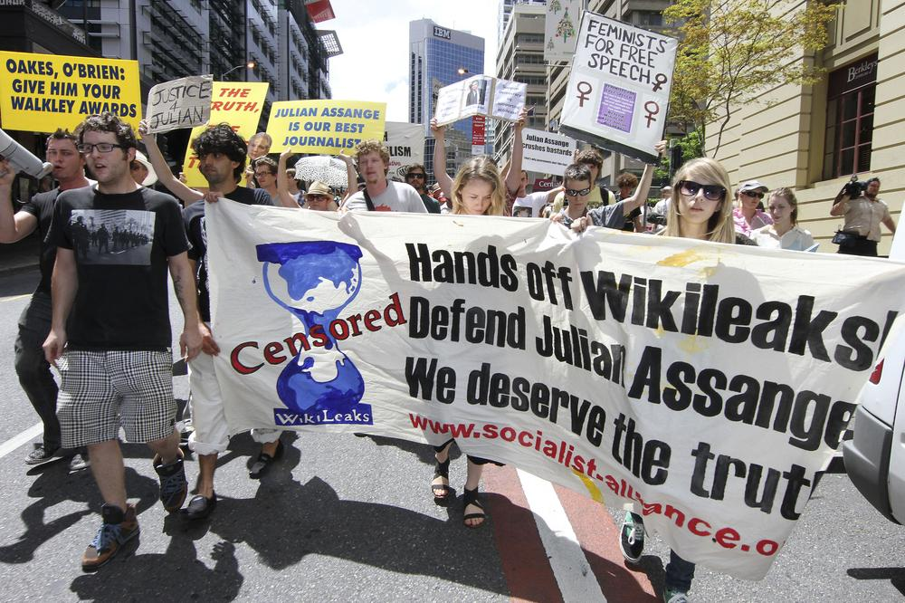 Hundreds of protestors march through Brisbane's city center to protest against the detention of WikiLeaks founder, Julian Assange, in Brisbane, Australia. (AP)