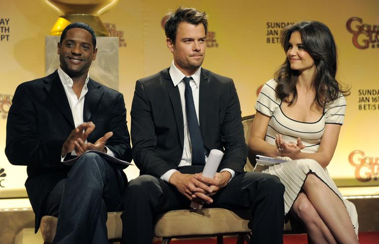 Actors Blair Underwood, left, Josh Duhamel, center, and Katie Holmes prepare to announce nominations for the 68th Annual Golden Globe Awards in Beverly Hills, Calif., Tuesday. (AP)