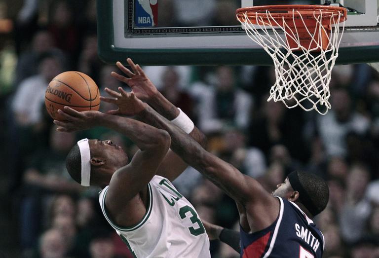 Boston forward Paul Pierce shoots over Atlanta forward Josh Smith during the second half of the game in Boston on Thursday. The Celtics beat the Hawks 102-90. (AP)