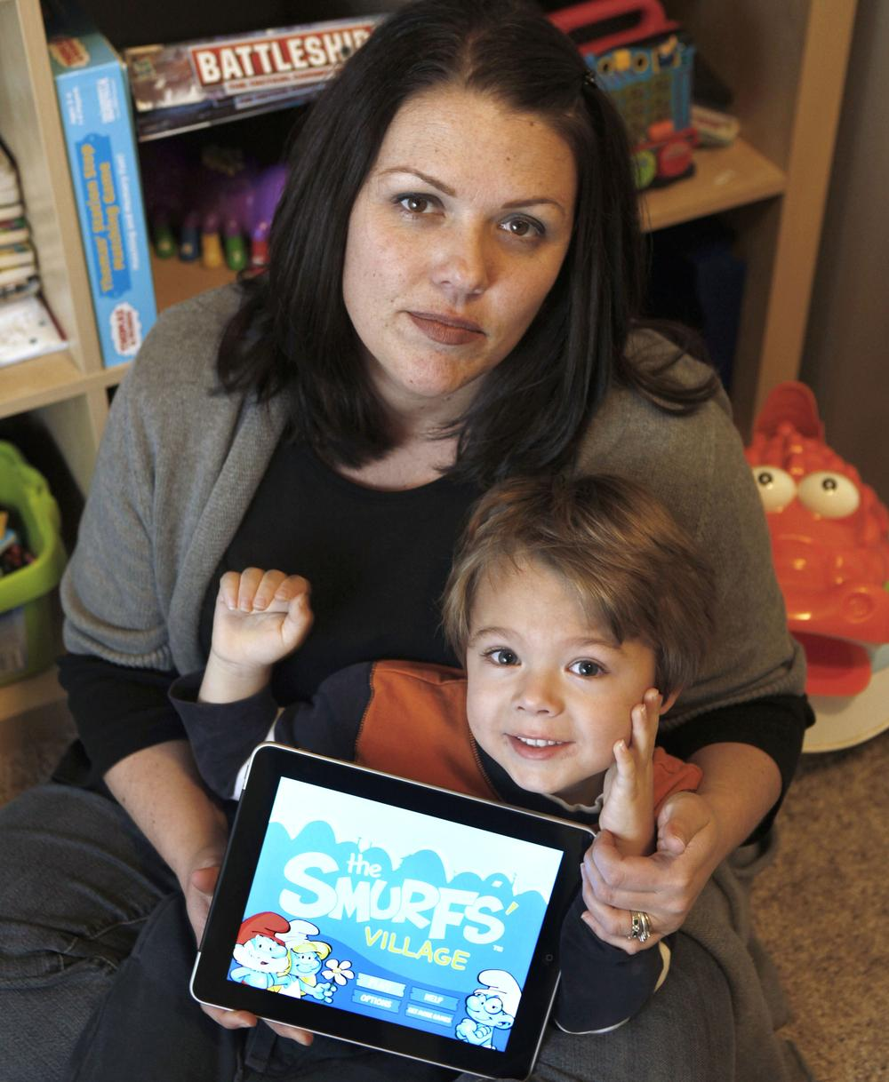 Kelly  Rummelhart and her son, Sawyer, 4, in their home in Gridley, Calif. (AP)