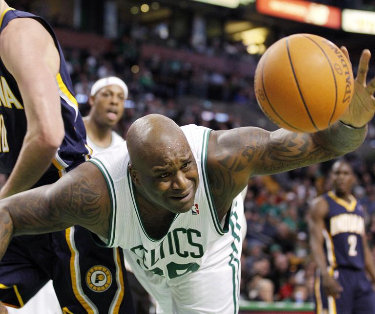 Boston's Shaquille O'Neal dives for a rebound during the second half of the game against Indiana in Boston on Sunday. The Celtics beat the Pacers, 99-88. (AP)