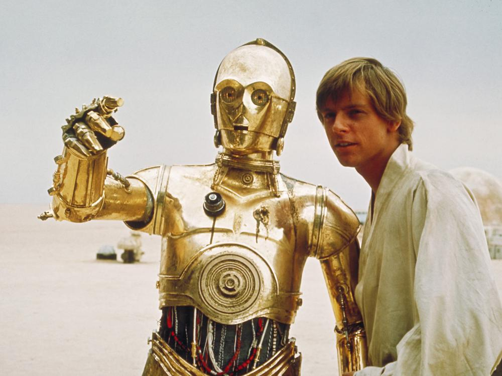 C3PO, the droll droid of Star Wars fame, is shown with the character Luke Skywalker, played by Mark Hamill. (AP/Copyright 2004 Lucasfilm Ltd. & TM. All rights reserved.)