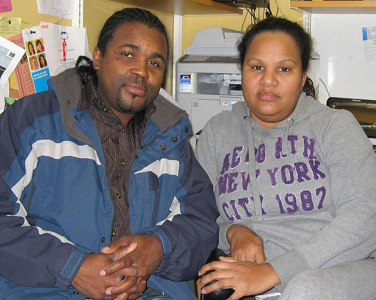After their Hyde Park home was taken, Pierre Solon and Katty Famila now live in an apartment in Mattapan. (Anthony Brooks for WBUR)