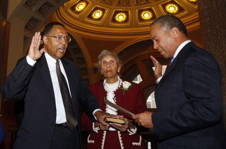 Gov. Deval Patrick, right, swears in new Chief Justice Roderick Ireland as Ireland's mother, Helen Ireland, holds the Bible on Monday in Boston. (AP)