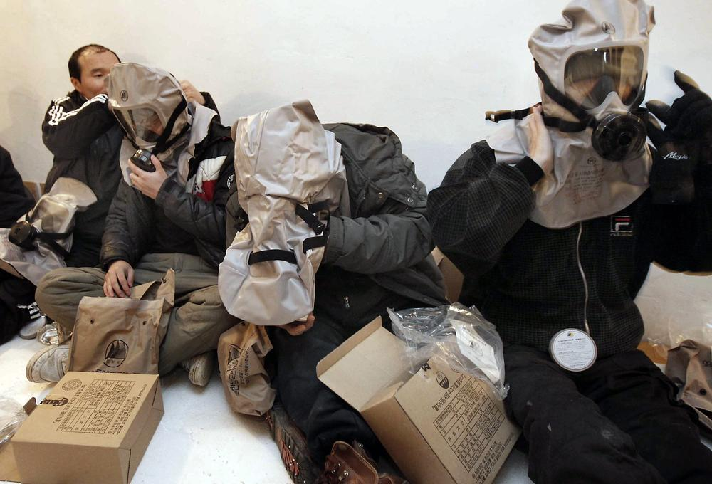 South Korean residents wear their gas masks at a shelter on Yeonpyeong island, South Korea. (AP)